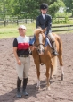 Virginia Bonnie and Prom Queen celebrate their equitation victory with Denice Perry.