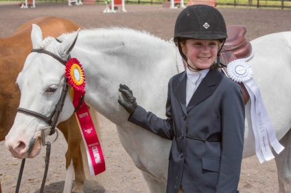 Virginia Bonnie with Wink And Smile enjoy their reserve championship in the Pony Hunters!